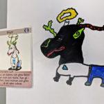 Visar bild av elevens förlaga och det färdiga kortet för monstret Hun.